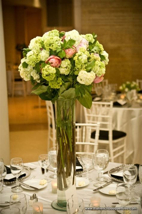 Vases Centerpieces by The Bouquet Inspiring Wedding Event