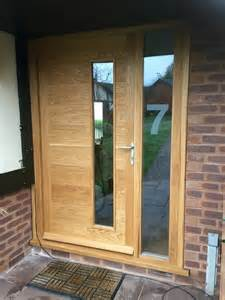 wooden front doors with side panels