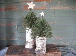2 woodland christmas trees on birch logs with by