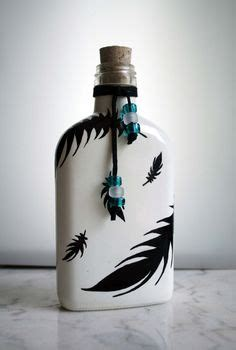 Black feathers on white backround flask or decorative bottle with cork