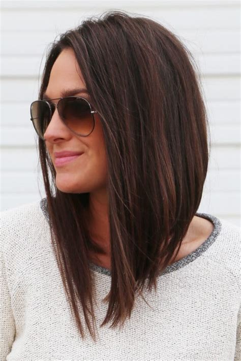 medium hairstyles that are angled towards the face long angled bob longbob pinteres