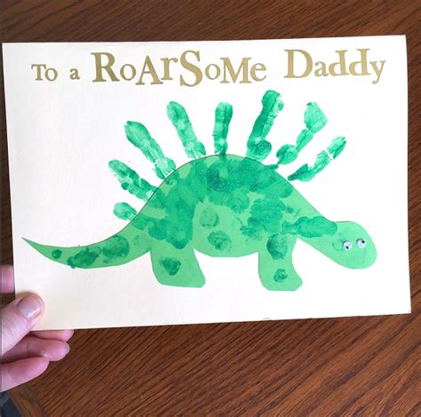 card handprint to a roarsome handprint dinosaur card for