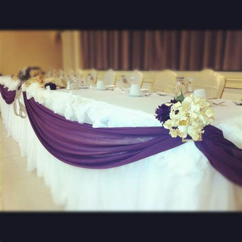 Elegant head table wedding decorations. Like the purple