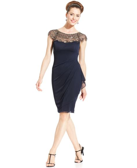 cap sleeve beaded illusion gown xscape cap sleeve illusion beaded dress in blue lyst