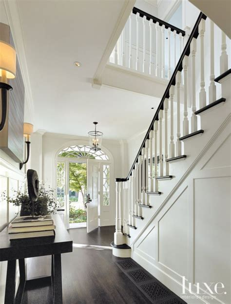 colonial foyer white dutch colonial revival entry luxe interiors
