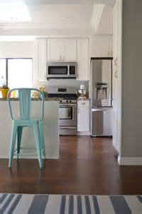Contrast of the snowbound white cabinets with the light french gray