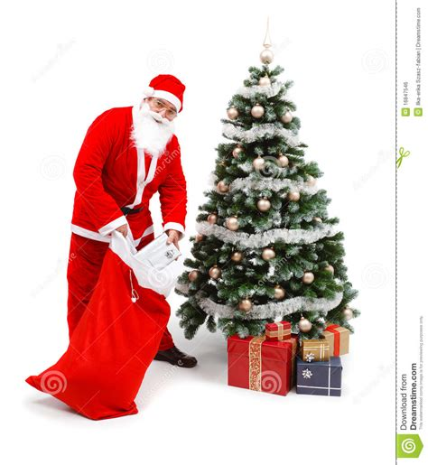 santa claus with gifts and christmas tree www imgkid com