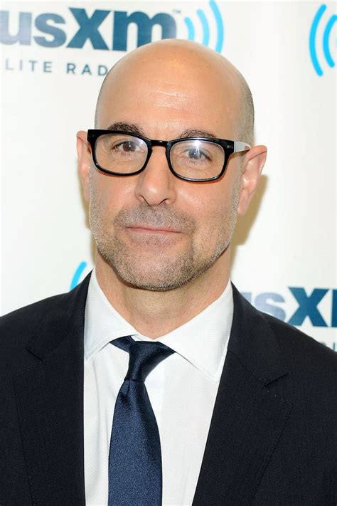 tall actor with glasses stanley tucci bald actors stanley tucci and yul brynner