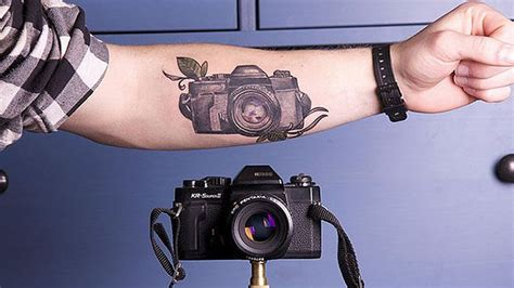 tattoo photographers the girl with the say cheese tattoo turns arm into camera