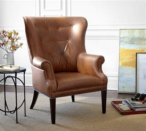 hatton tufted wingback leather chair 1300 34 75 quot w x 35 quot d x 44 5 quot x2 to flank the fireplace
