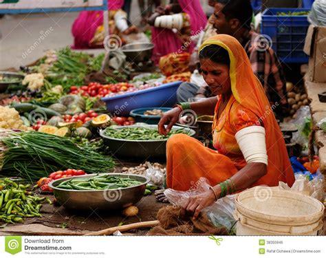 vegetables z wave vegetable seller in the bazaar in india editorial photo