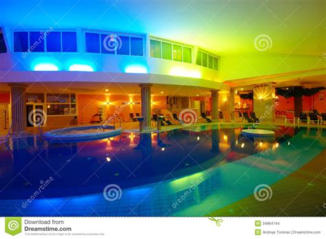 night view of roman style swimming pool with deck jets indoor hotel swimming pool by night editorial stock image