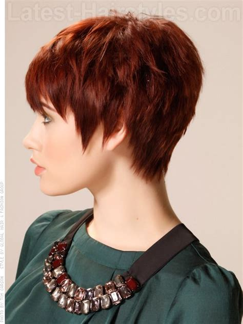 short ha jagged edges auburn pixie with long spiky bangs side view