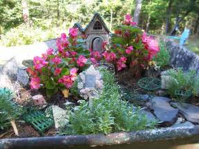 two cottages and tea wheelbarrow fairy garden