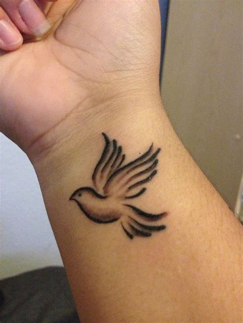 dove with olive branch tattoo i d want a pair of doves similar to these and one with an