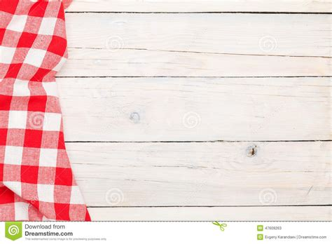 red towel  wooden kitchen table stock photo image