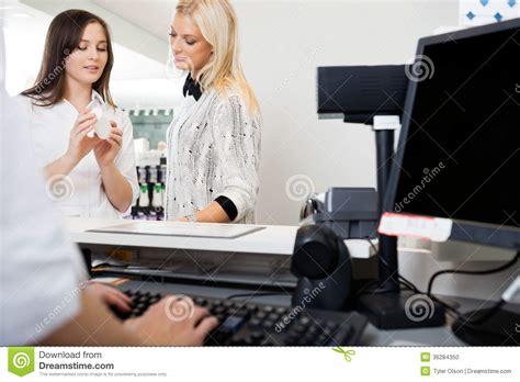 sales clerk assisting in pharmacy stock photo image 36284350
