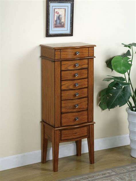 powell woodland oak jewelry armoire powell woodland oak jewelry armoire with lift off jewelry box pw 604 317 at homelement com