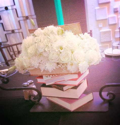 ideas matri on pinterest 31 pins centerpiece with books for graduation party by dezign shop