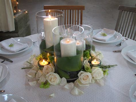 Cylinder Vases With Floating Candles And Flowers by Centerpieces Trio Of Pillar Candles Wrapped In Green Ti