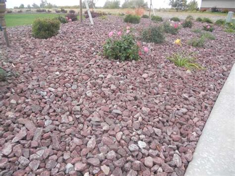 montana red rock landscape wolverine rock and mulch