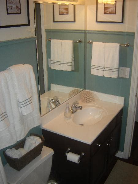 brown painted cabinets in cottage bathroom behr cloud burst