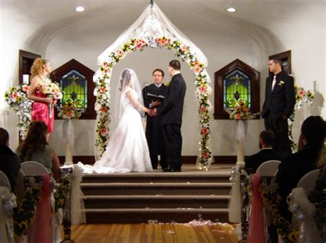 wedding arch omaha pink white yellow altar arch arrangements indoor ceremony