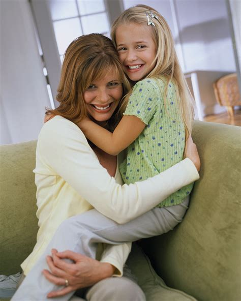 mother daughter mother and daughter hugging on a chair dating with