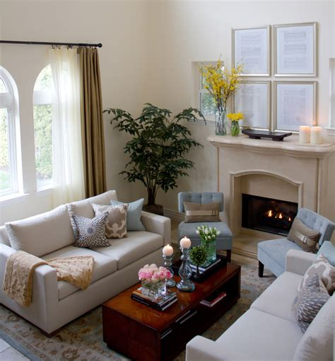 Living Rooms With Two Sofas Two White Sofas And A Wooden Coffee Table In Front Of A Fireplace Interior Design Ideas