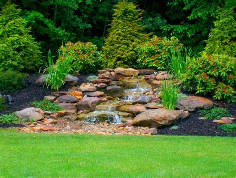 stone waterfalls backyard cleveland landscape design services exscape designs