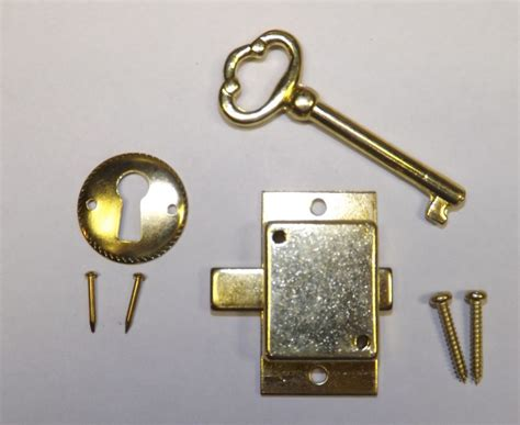 howard miller curio cabinet key howard miller older style grandfather clock door lock key