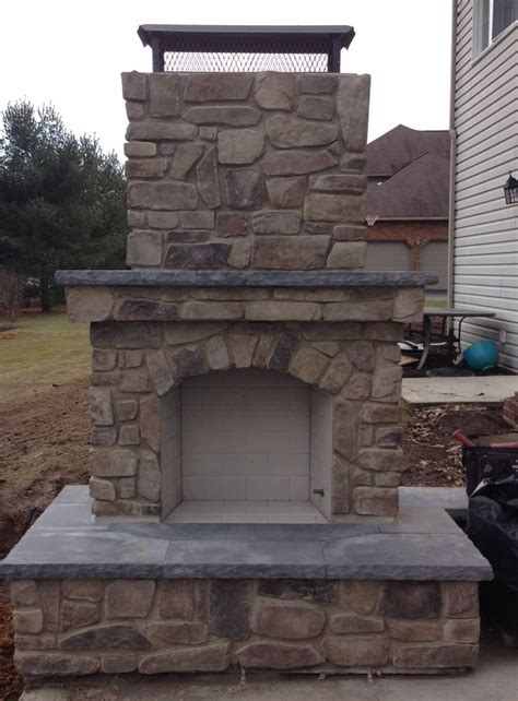 outdoor fireplace with stone veneer home pinterest