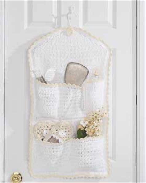 hanging bathroom organizer pocket hanging storage crochet pattern favecrafts com