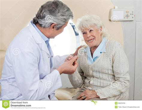 doctor comforting patient doctor comforting senior female patient royalty free stock