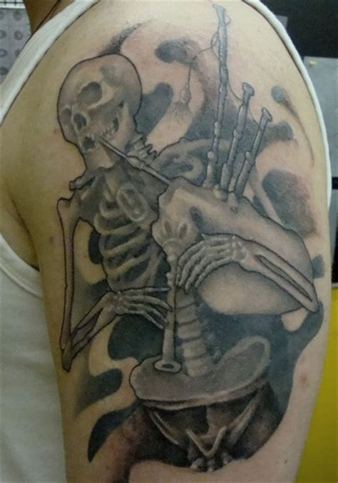 bone daddy tattoo v bone bagpiper