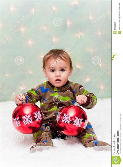 new born baby xmas photo baby in pajamas holding ornaments stock image image 17383071