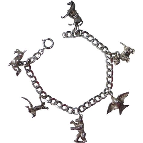 beau sterling silver animal charm bracelet from bejewelled