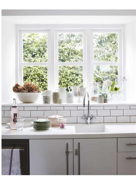 window behind kitchen sink home pinterest