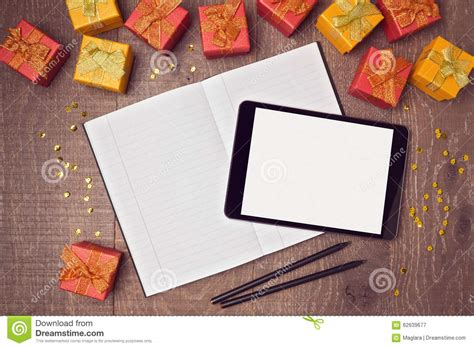 Digital Mock Up Templates Digital Tablet Mock Up Template With Gift Boxes And Notebook On Wooden Desk View From Above