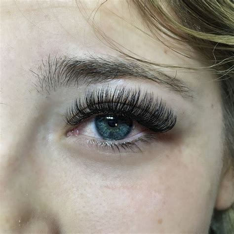 women in 60s with eyelash extensions to curled and to many lashes eyelash extensions