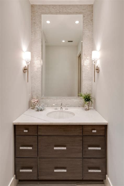 polished nickel mirror powder room transitional with