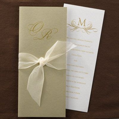 tie ribbon around wedding invitation this pearl shimmer card has a gold wrap with a chiffon