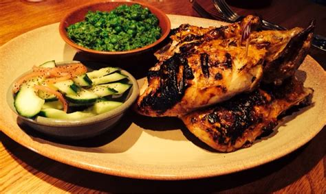 whole grilled chicken with 2 sides i chose macho peas cucumber poppyseed salad yumm yelp