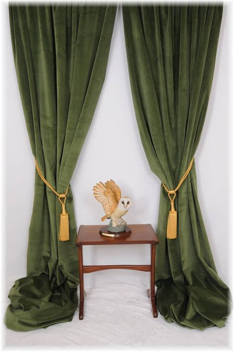 long green curtains this store is awesome for my velvet curtains i will be