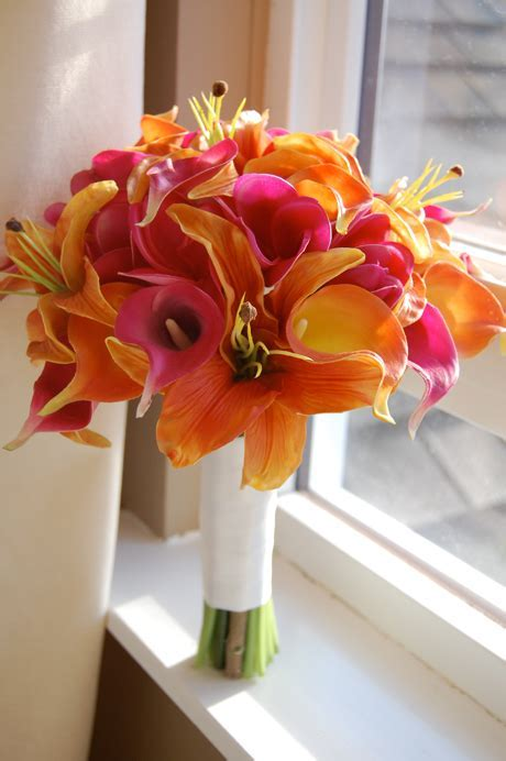 Orange and fuchsia plumeria, tiger lilies and calla lilies