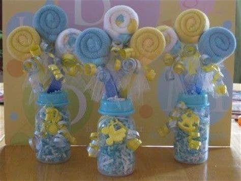 baby bottle centerpieces baby shower rolled up washcloths on baby utensils with baby bottle