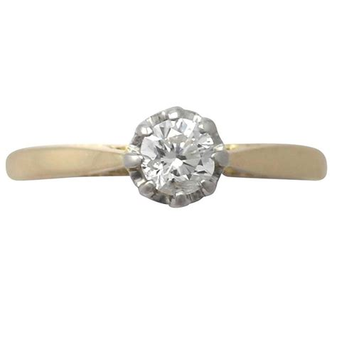 0 38ct and 18k yellow gold platinum set solitaire
