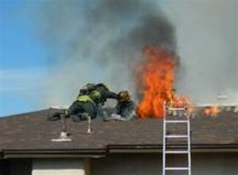 anaheim firefighter falls through roof the one handed grab photo shows rescue of las
