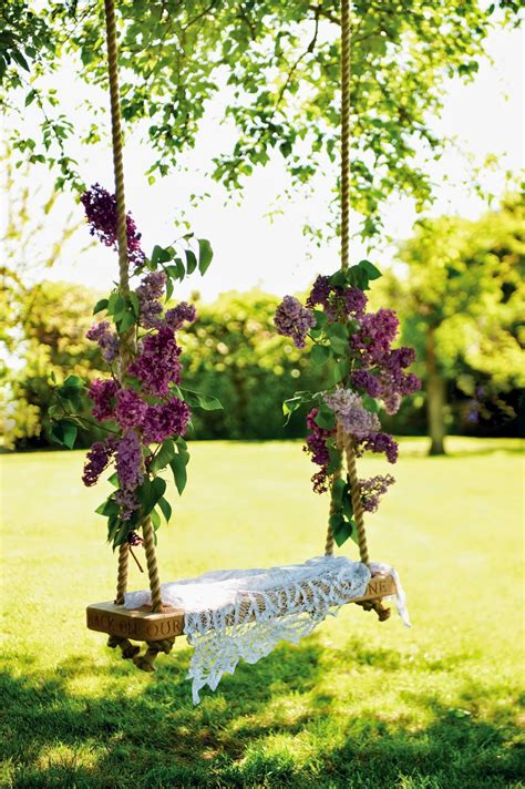 swing in backyard garden swings the enchanting element in your backyard