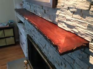 crafted live edge slab fireplace mantle by mad custom